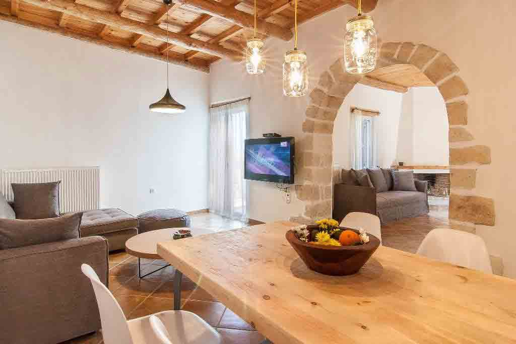 Exposed brick and a wooden coffered ceiling add character to the living spaces. Image: A Place in Crete / Rightmove