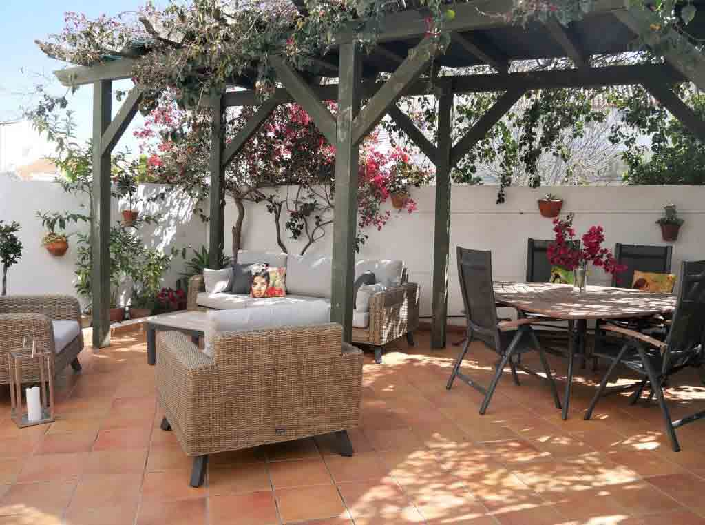 This idyllic holiday apartment includes a private terrace for soaking up the sun. Image: Portugal Realty