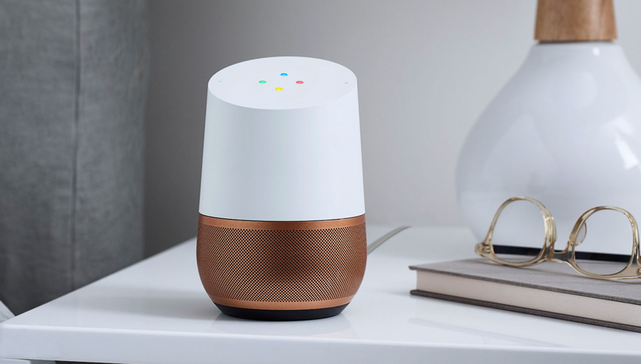 Google Home smart device in white with a copper base