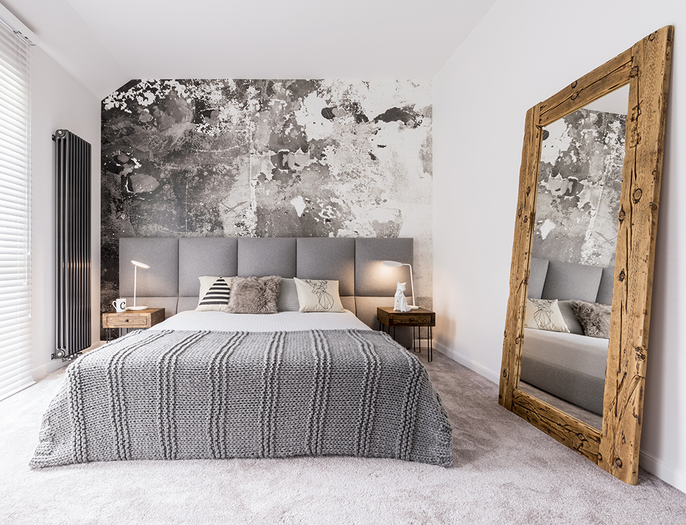 Narrow bedroom with feature wall