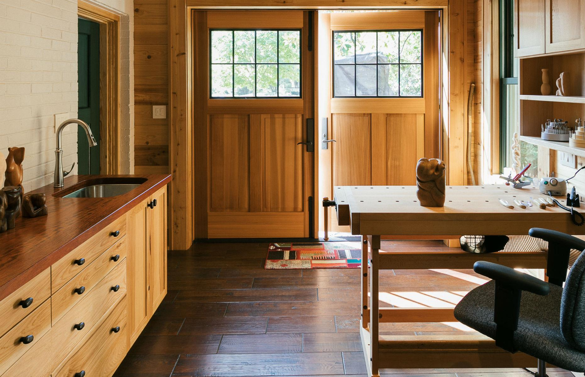 The garage of this 85-year-old home was transformed from a sad storage space into a sleek studio. Image:Handcrafted Homes, Inc.