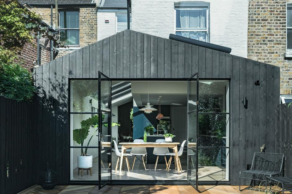 This side and rear extension with black charred cladding was completed by SAM Architectsand Lunar Architects. Image: Da Feng