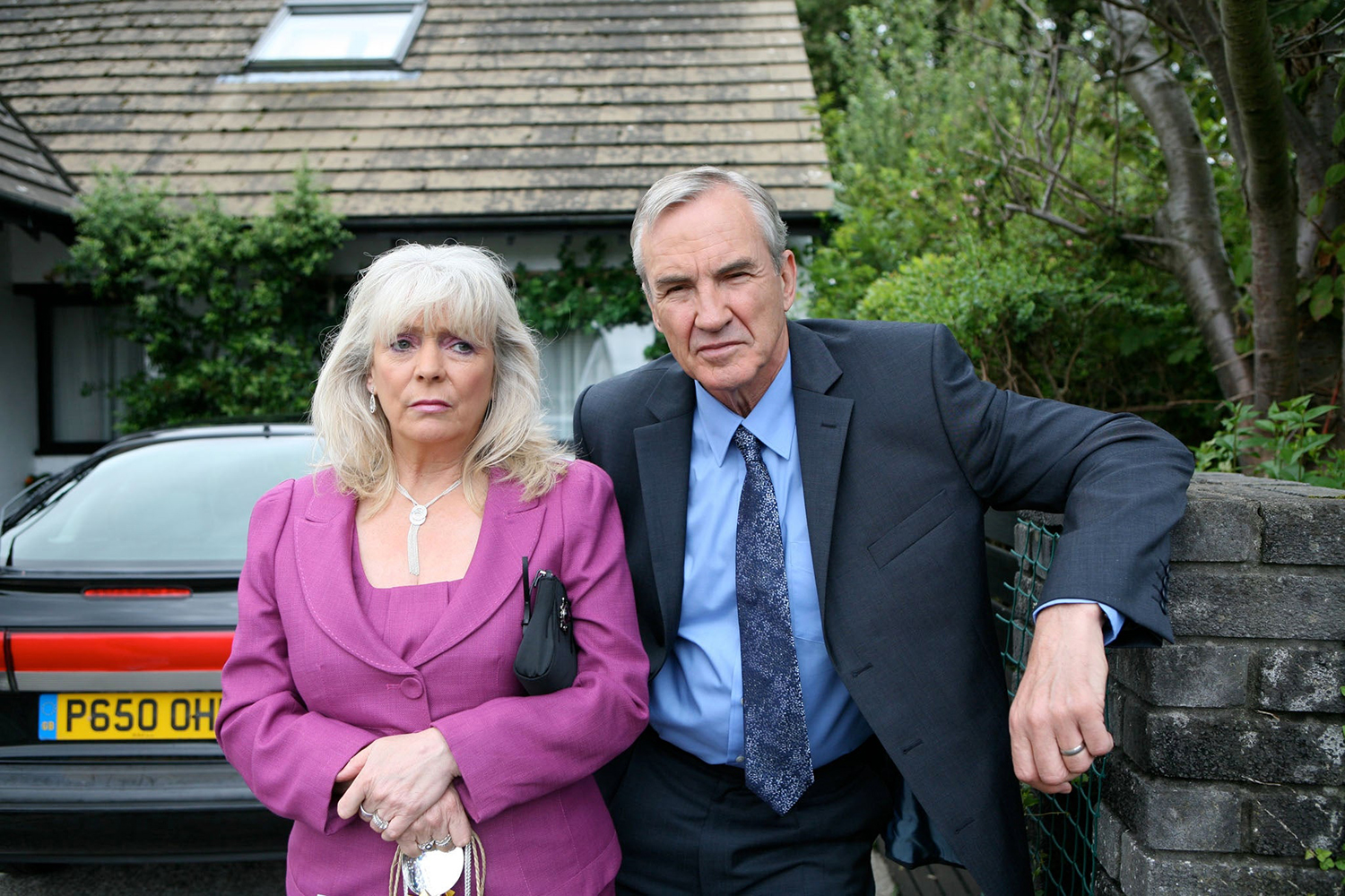 Pam and Mick Shipman in front of the Billericay bungalow. Image: BBC