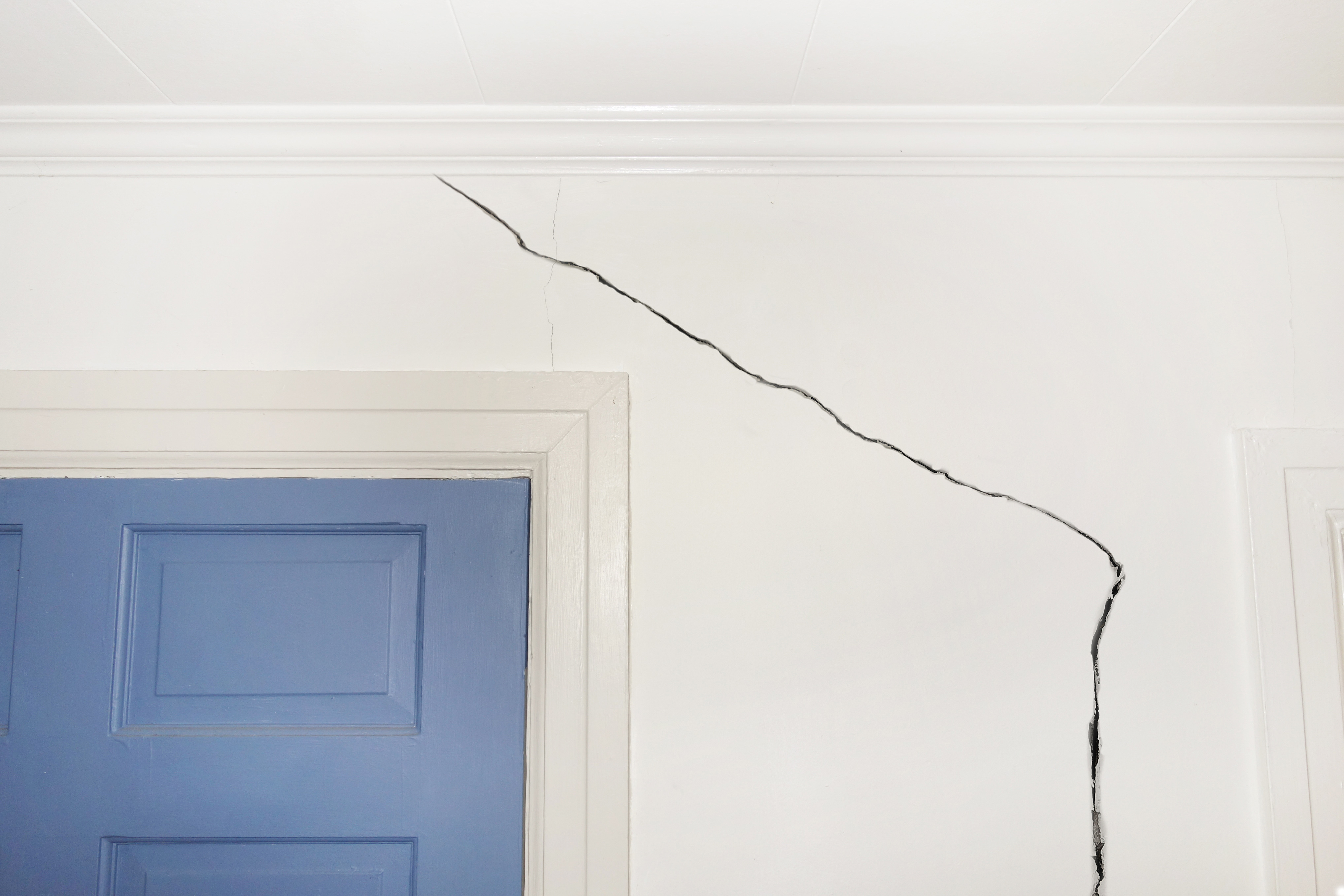 Tell-tale cracks around windows and doors can suggest structural problems. Image: zimmytws/Shutterstock
