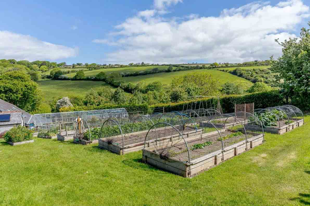 The kitchen garden features far-reaching views of the countryside. Image: Christie's International Real Estate