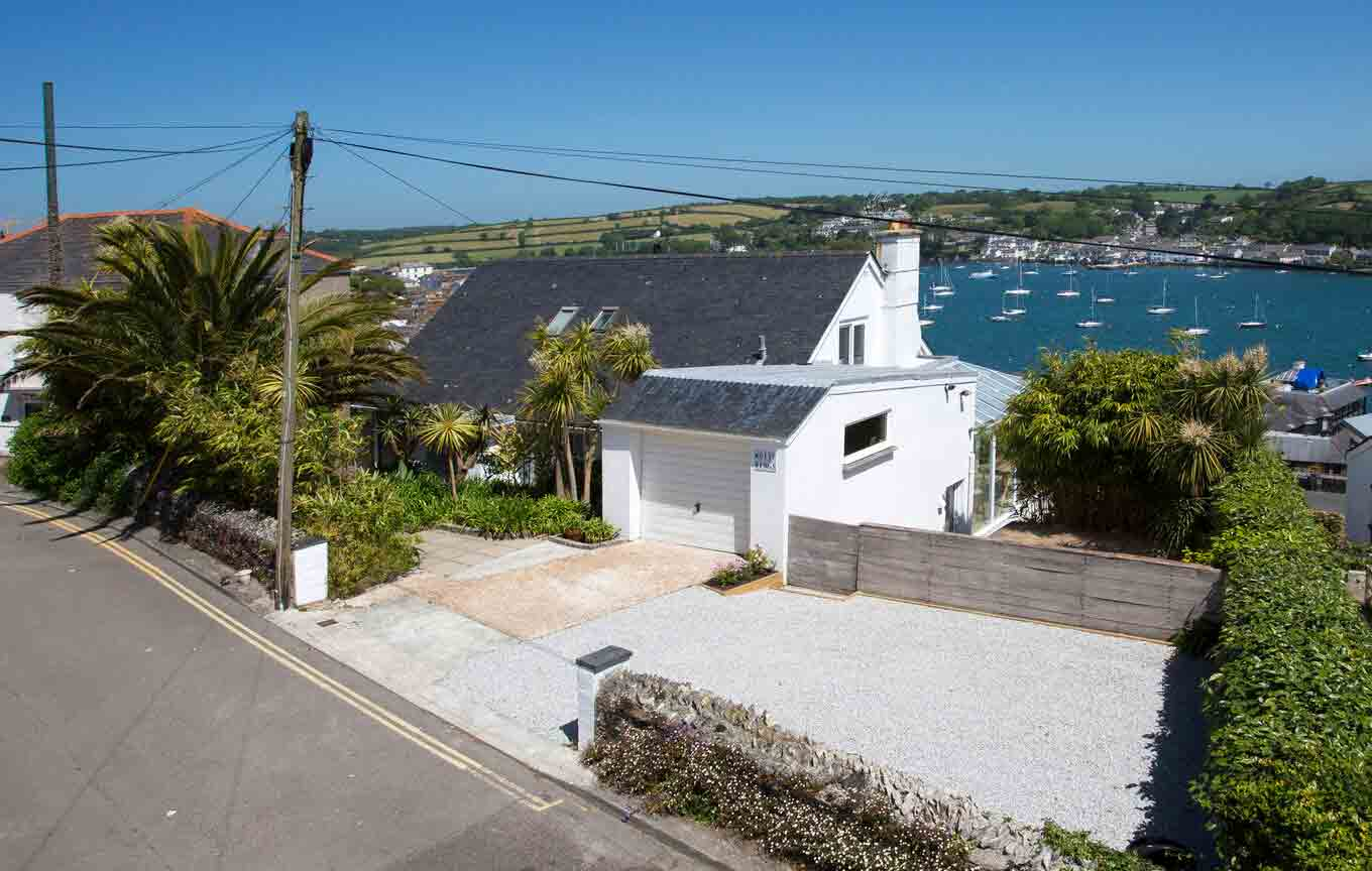 The stunning home is perched on the hillside overlooking the harbour. Image: Jonathan Cunliffe