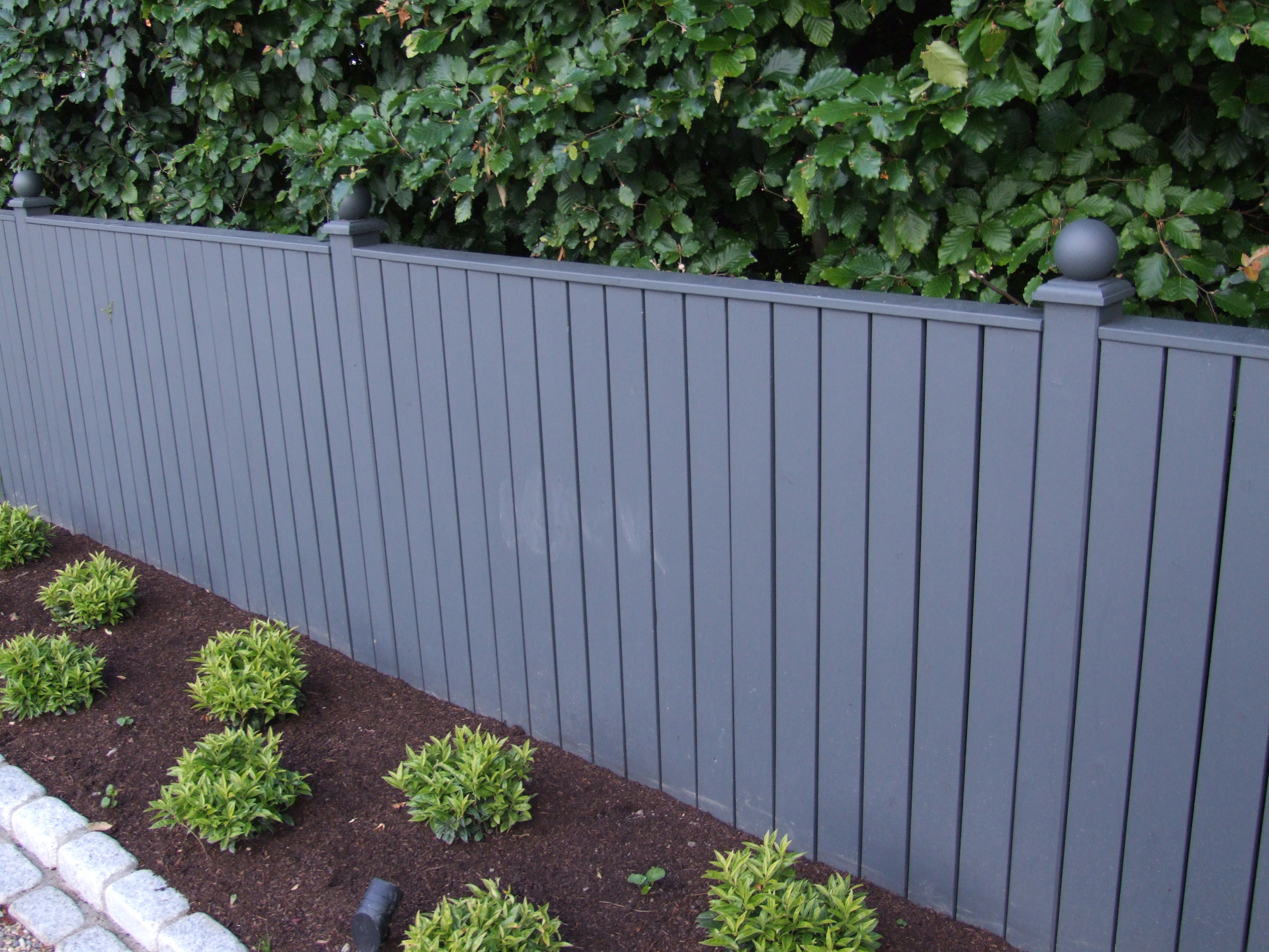 Fix garden fencing to create a smart backdrop. Image: Serenitylandscapes.com
