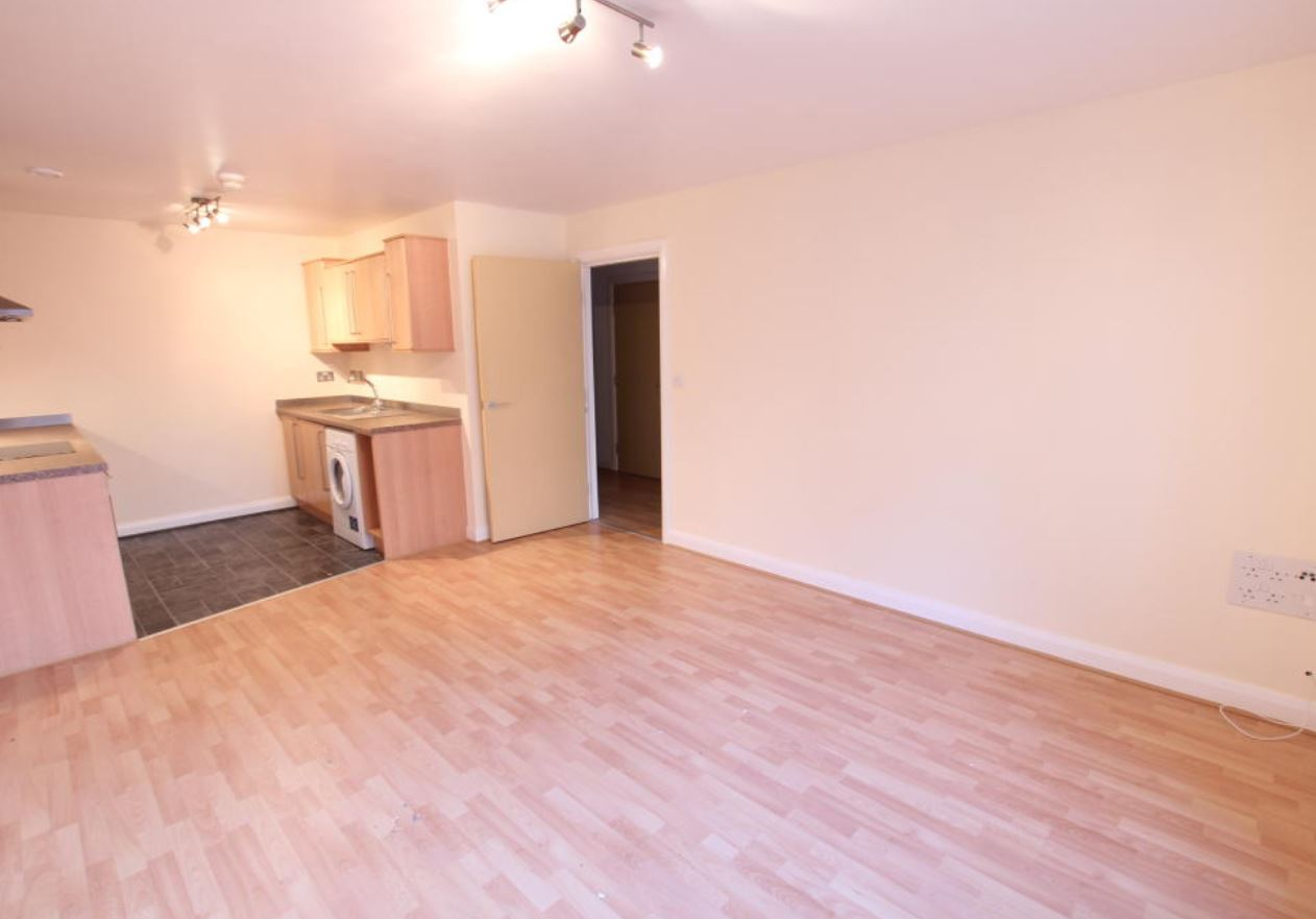 The two-bed flat has an open-plan layout with a small kitchen. Image: Rightmove
