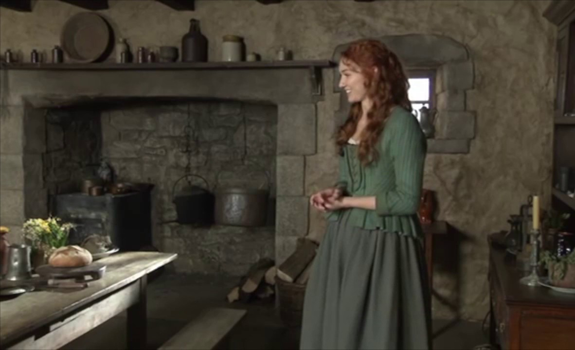 Actress Eleanor Tomlinson on the set of Poldark, with the infamous wooden table. Image: BBC