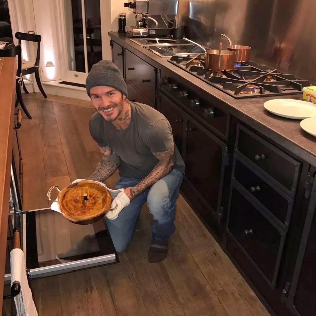 David Beckham shows off his baking skills in their cool kitchen. Image: @victoriabeckham / Instagram