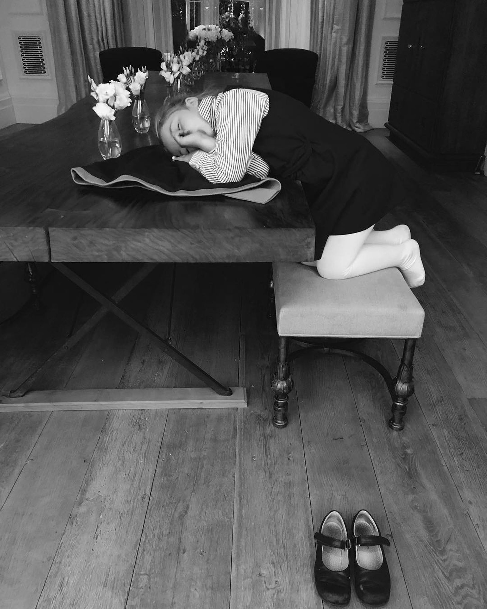 Harper Beckham proves a wooden table is an all-rounder. Image: @victoriabeckham / Instagram