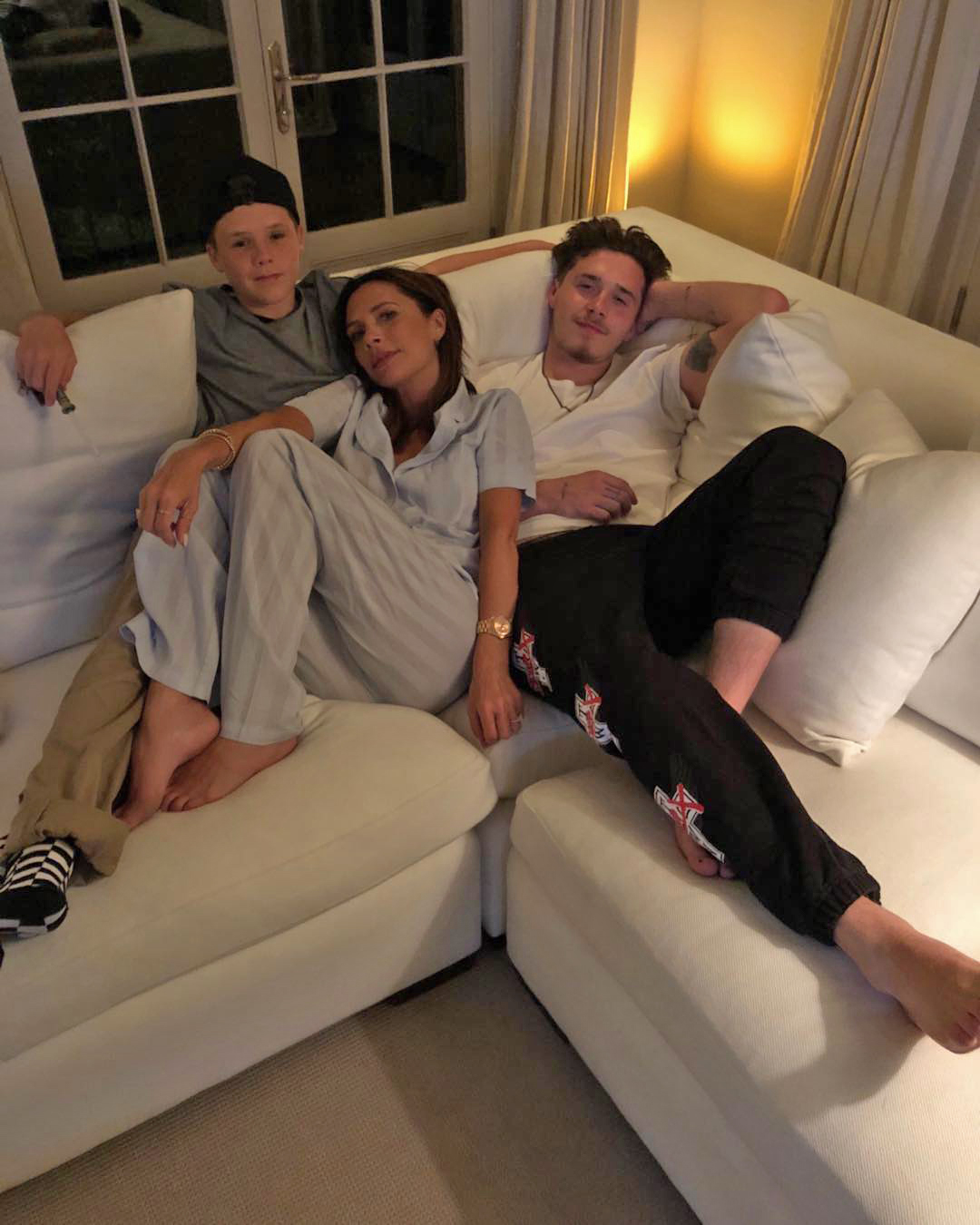 A white corner sofa is the perfect spot for the Beckham family to relax. Image: @victoriabeckham / Instagram