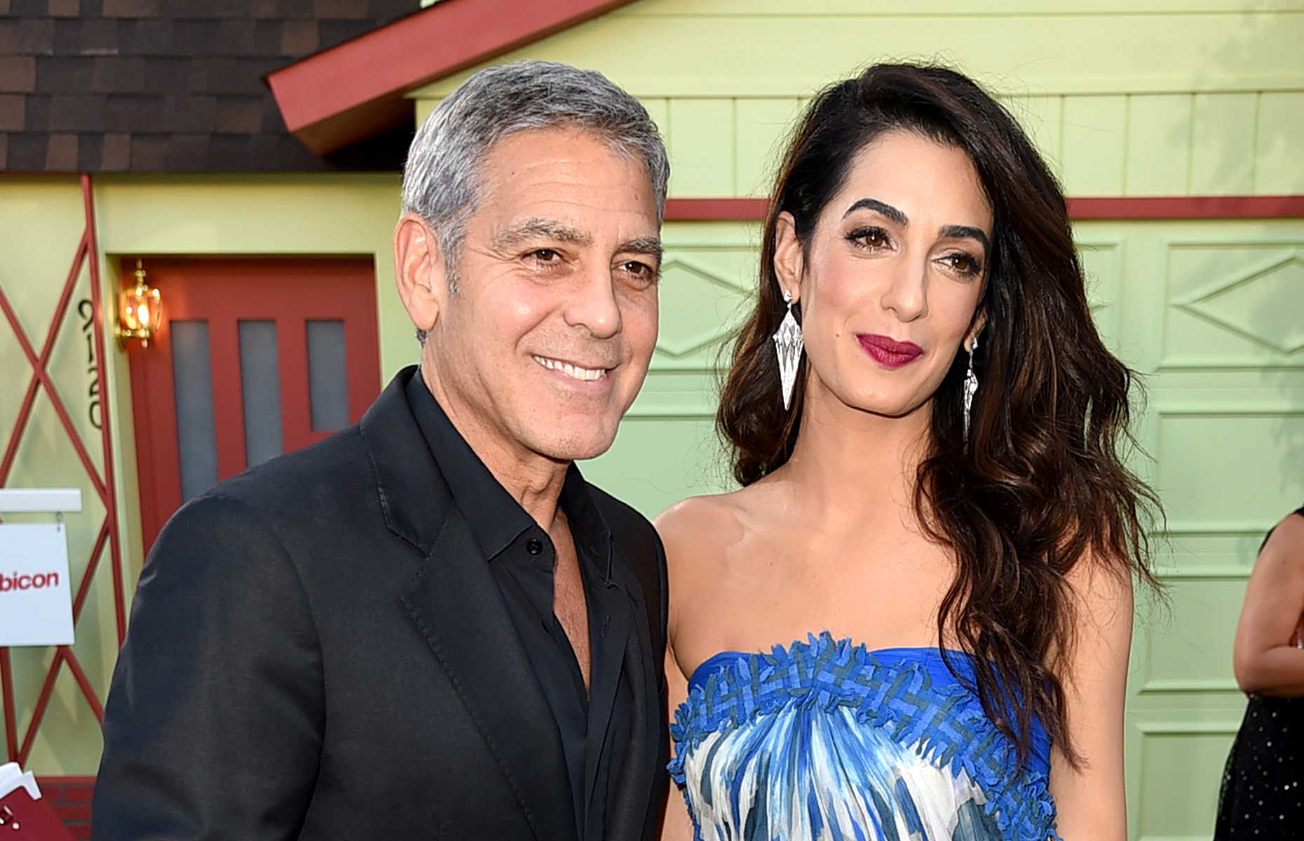 George and Amal Clooney will serve lunch to you and a guest if you win the fundraising raffle. Image: Kevin Winter/Getty Images
