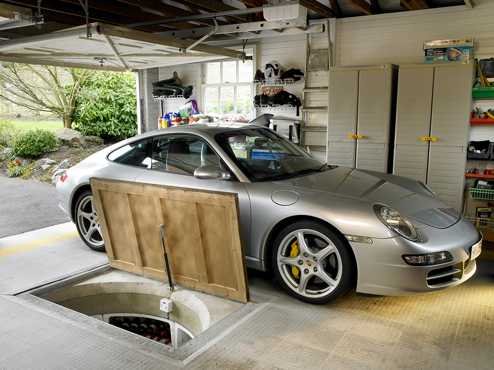 A hidden wine cellar in a garage - By Spiral Cellars