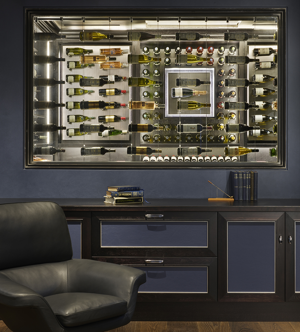 Glass wine cabinet in the wall of a study - by Spiral Cellars