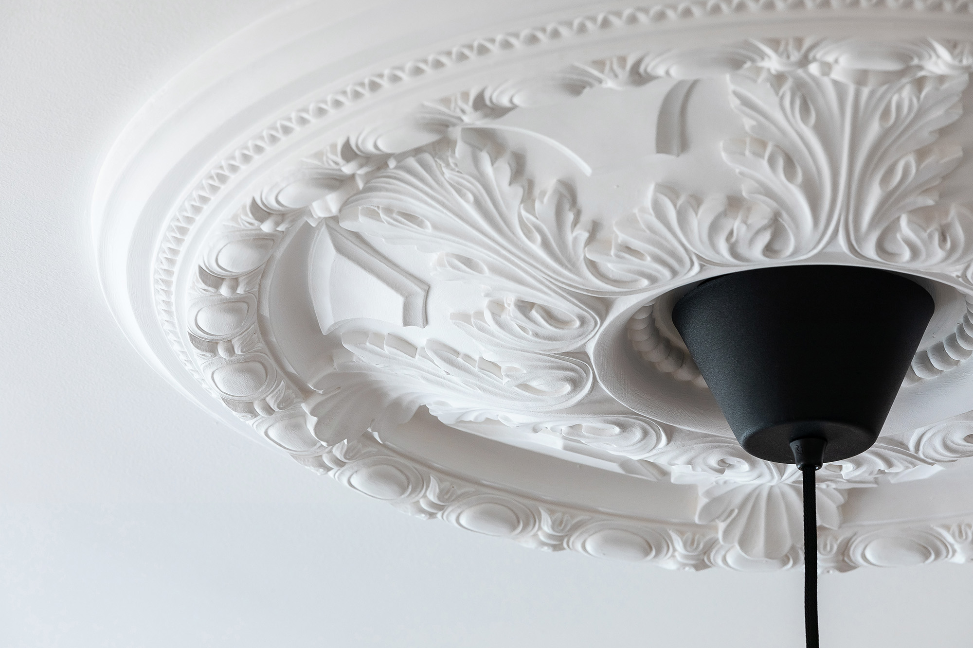 Original details like ceiling roses can add no end of character to a modern living space. Image: Create Bespoke