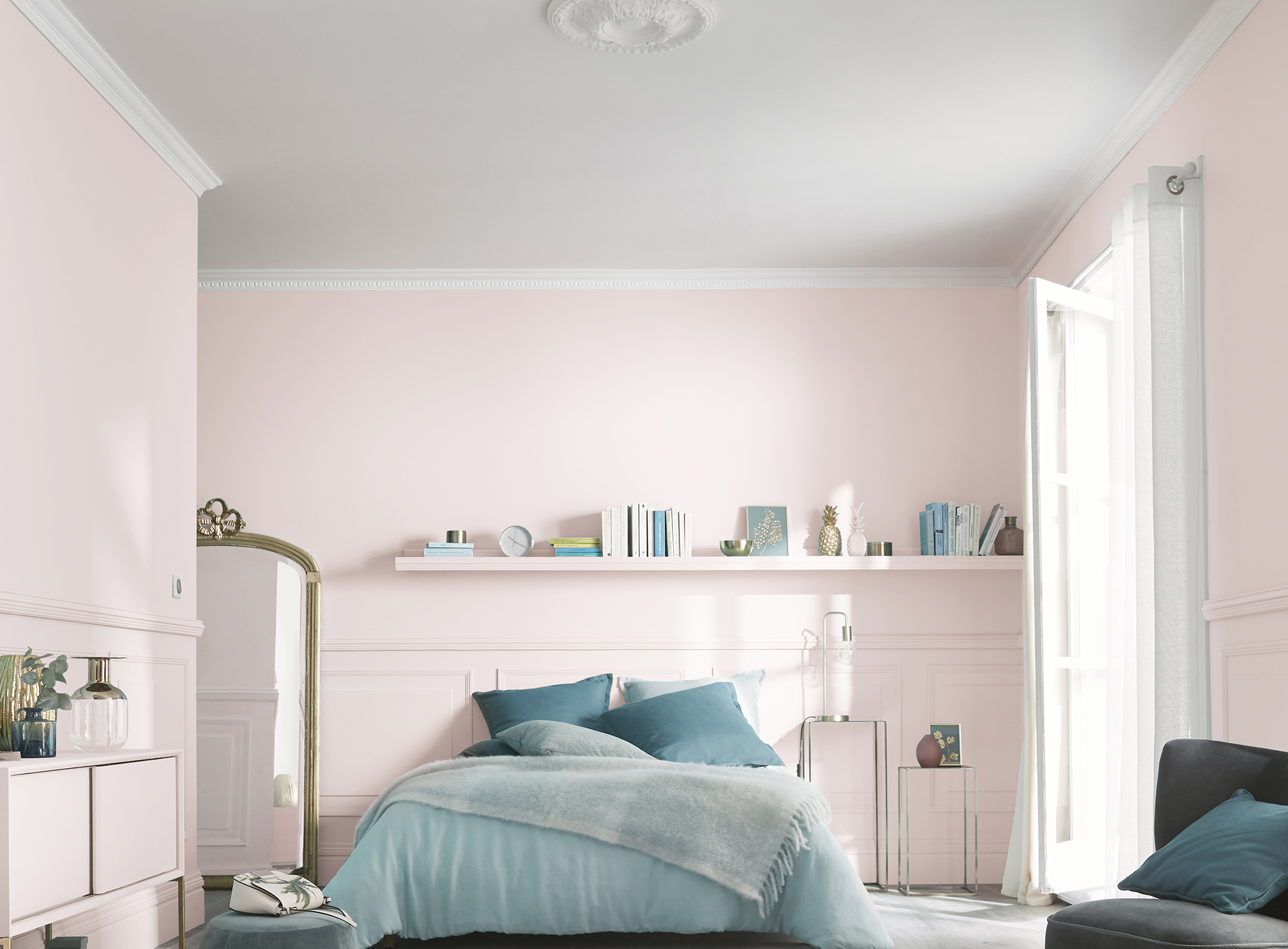 A dado rail and panelling add heritage charm to this modern blush pink bedroom. Image: B&Q