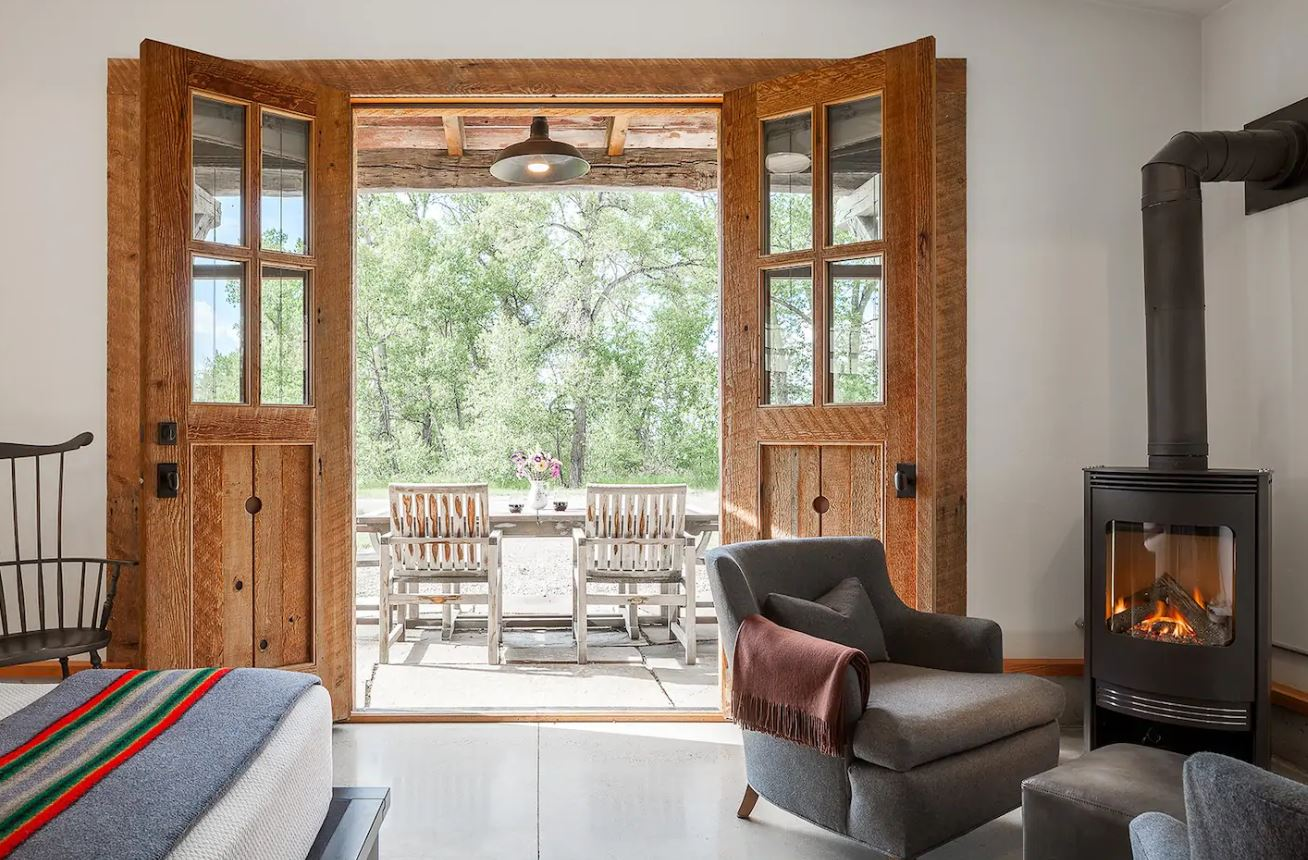 These warm wooden doors are the perfect addition to a rustic, homely bedroom. Image: Mary/Airbnb