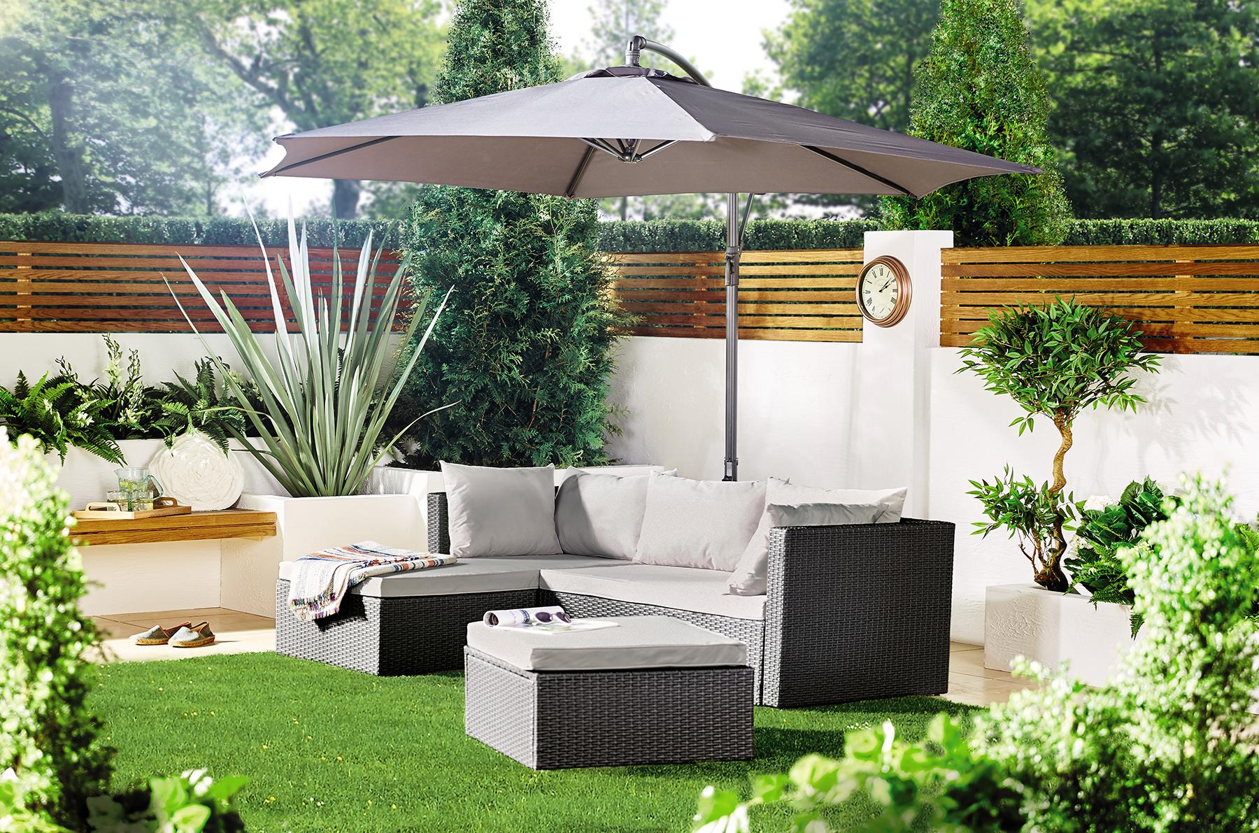 Rattan outdoor sofa and parasol. Image: Aldi