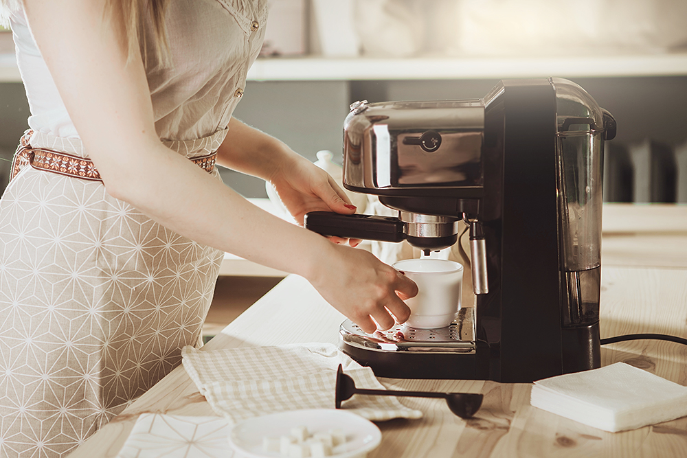 Regularly clean your coffee machine to keep bacteria at bay. Image: Nataliia Zhekova/Shutterstock