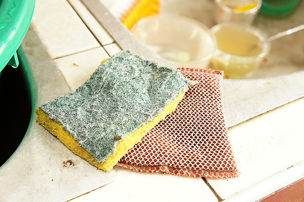 Replace your cleaning sponges every few weeks for a cleaner home. Image: girl-think-position/Shutterstock