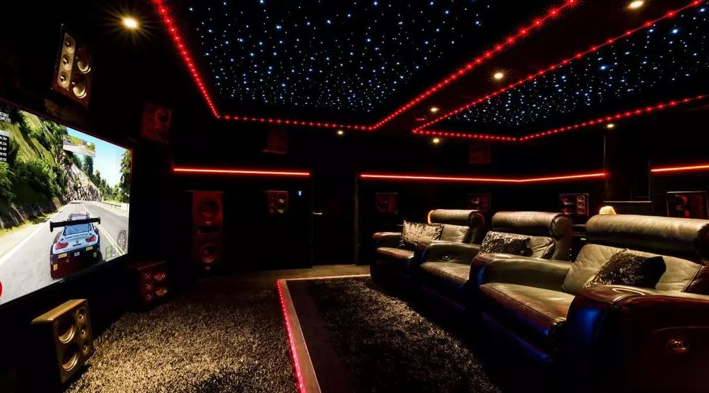 The spectacular home cinema is decked out with plush tiered seating. Image: OnTheMarket