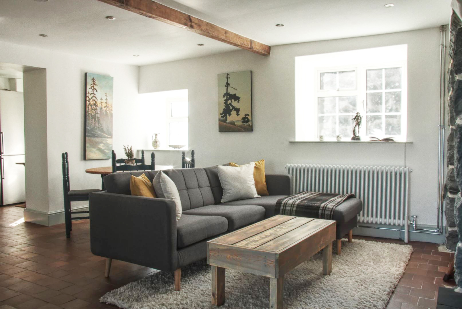 Rustic beams abound in the stylish living room. Image: Cwellyn Dream