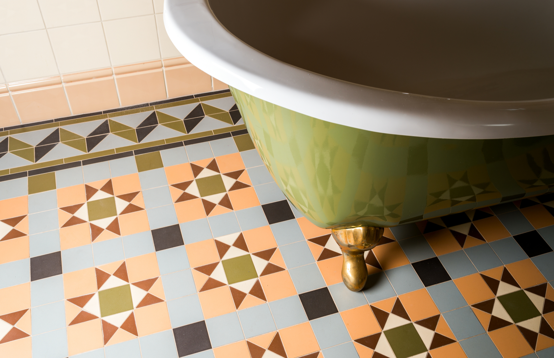 This bathroom wows with a patterned tiled floor, complete with an intricate border. Image: P A / Shutterstock