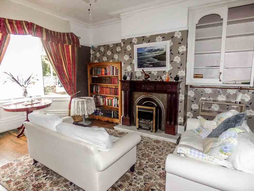 Period features abound in this living room, from the coving to the panelled bay window. Image: Pattinson