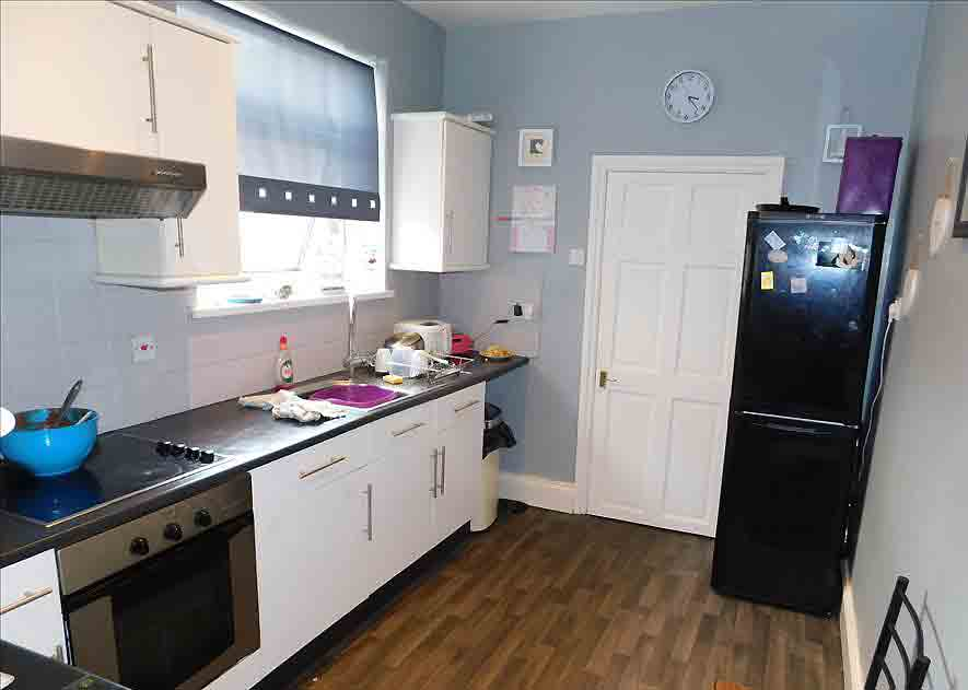 While in need of an update, the kitchen features reasonably modern fixtures. Image: Dowen