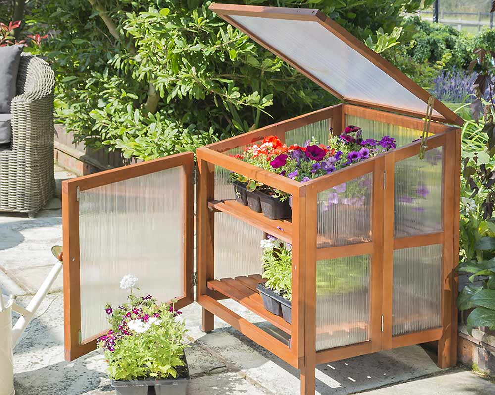 This handy elevated cold frame is ideal for smaller spaces. Image: Crocus
