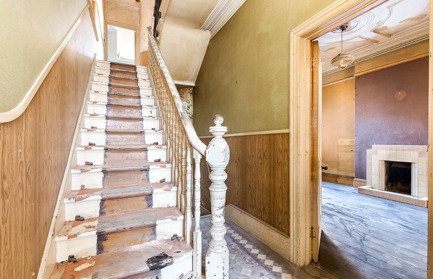 Despite its condition, the property's sweeping Edwardian staircase is still impressive. Image: Savills